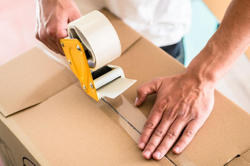 Man packing moving boxes